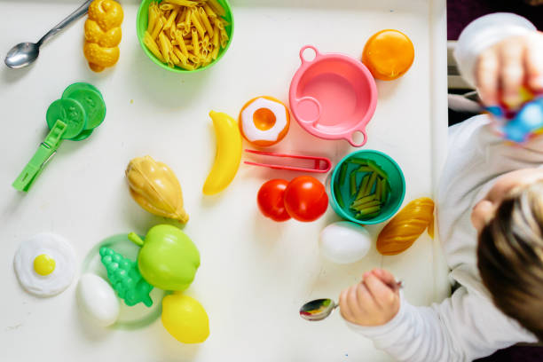 Two children entertain themselves with food toys.