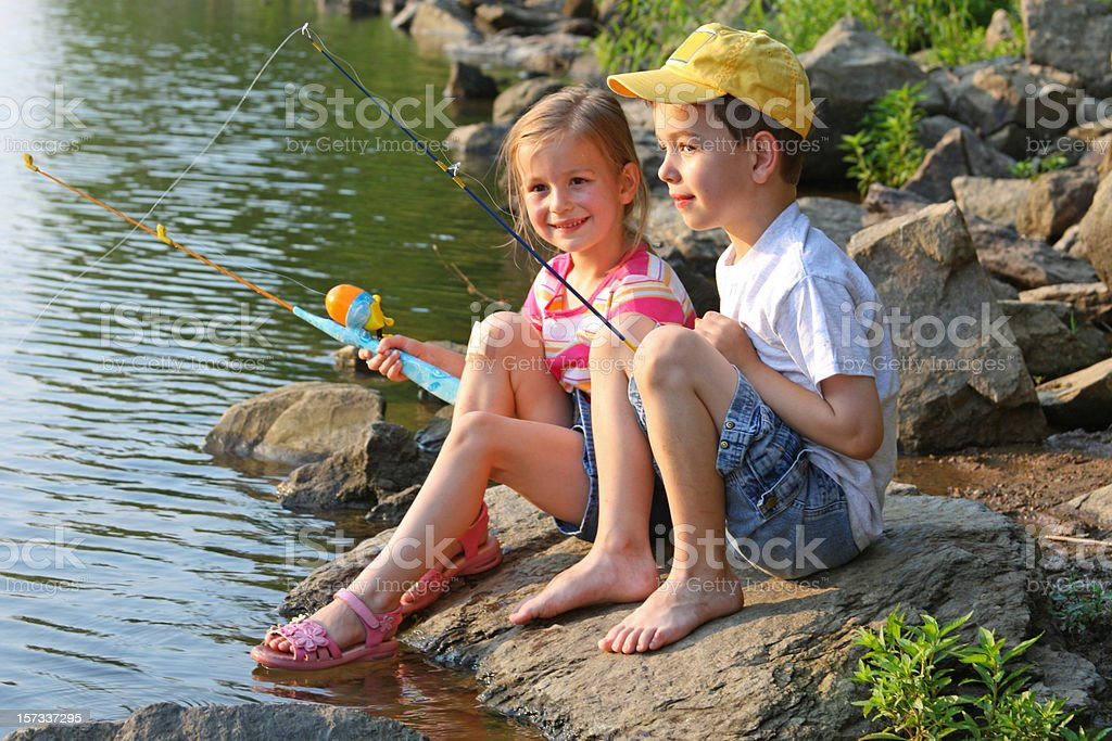 Two children fishing at the lake royalty-free stock photo