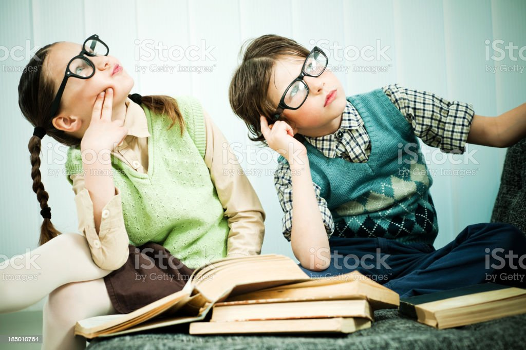 Two children geeks looking up. stock photo