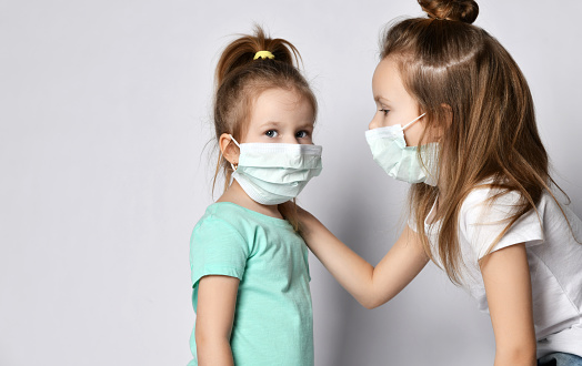 Two Children Girls Kids Are Afraid Of The Disease In ...