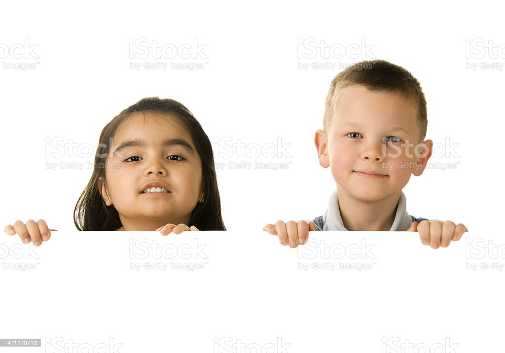 Two children holding a blank sign royalty-free stock photo