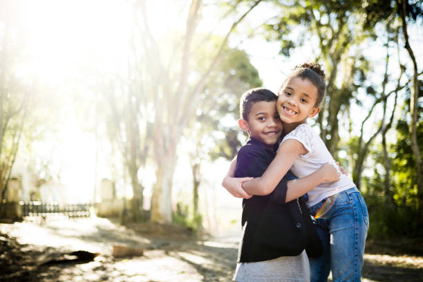 Two children hugging each other stock photo