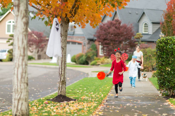 Two Children in Halloween Costumes Trick or Treating stock photo
