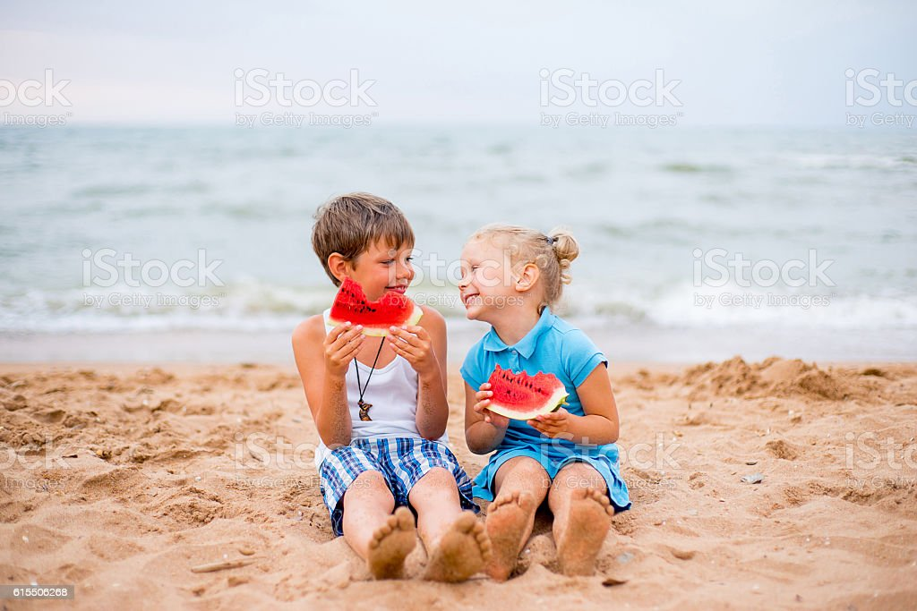 two children on beach stock photo