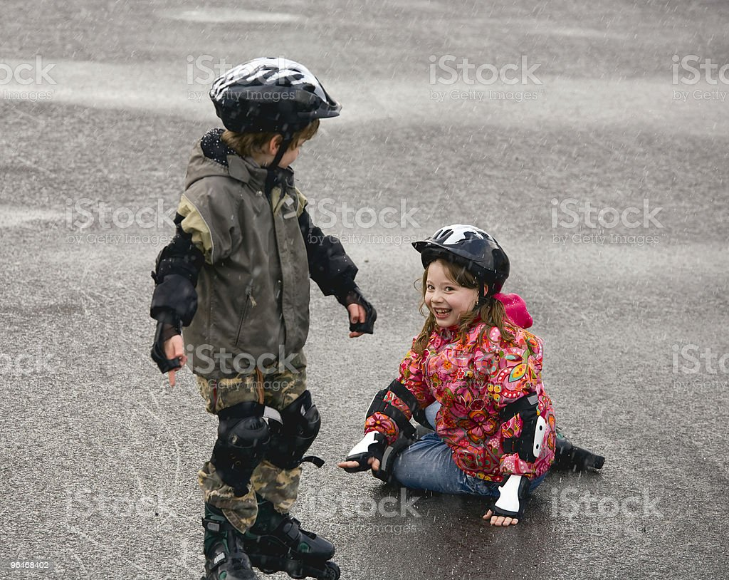 Two children on roller skates royalty-free stock photo
