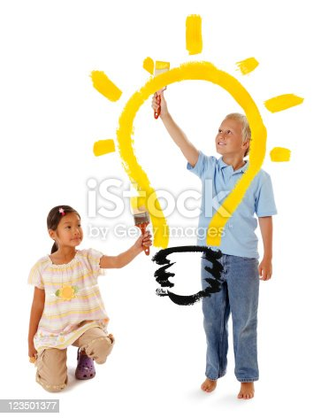 123499844istockphoto Two Children Painting a Light Bulb 123501377