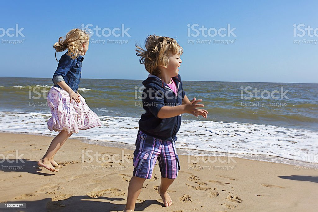 Two Children Playing on Beach royalty-free stock photo