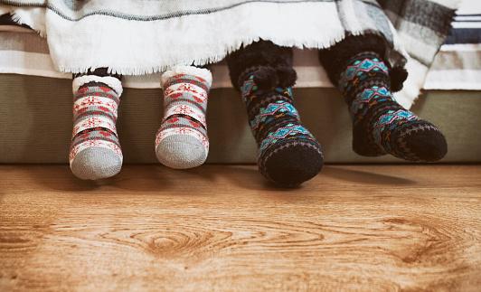 Two children wearing winter knit anti-slip socks