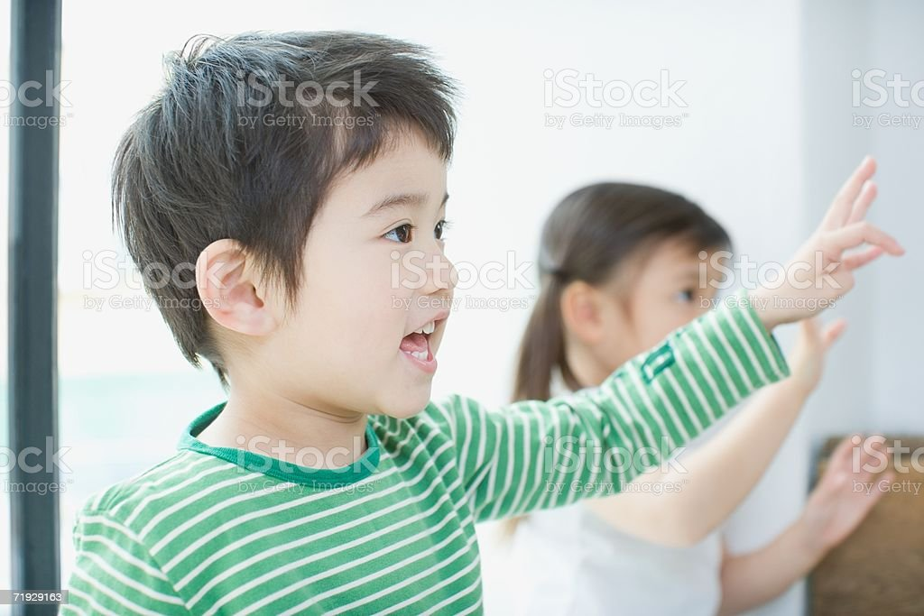 Two children with arms raised royalty-free stock photo