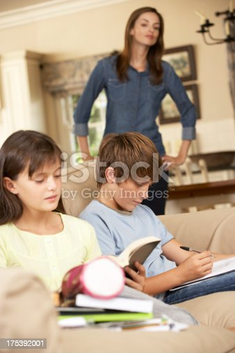 istock Two Children With Homework Sitting On Sofa At Home 175392001