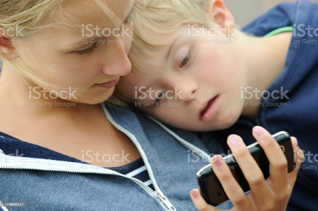 Two children with mobile phone royalty-free stock photo