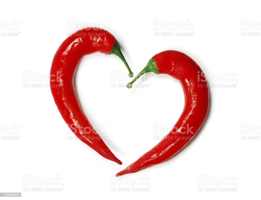 Two chili peppers forming a shape of heart stock photo