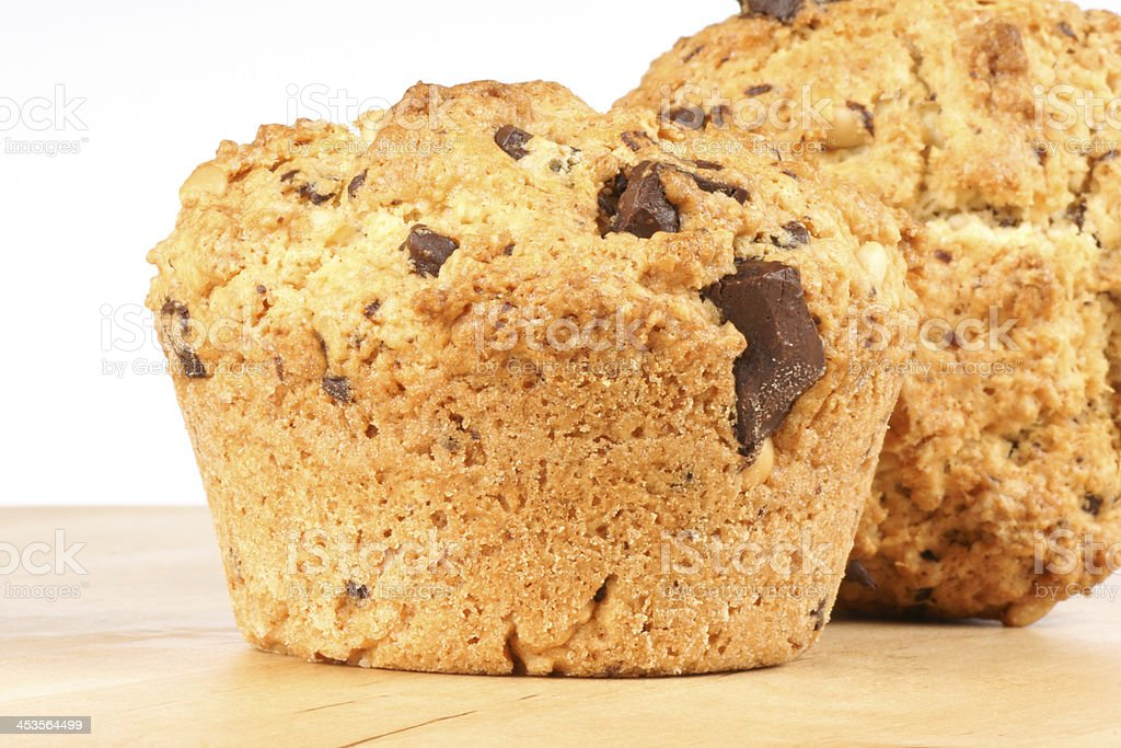 Two chocolate chips and pine nuts muffins royalty-free stock photo