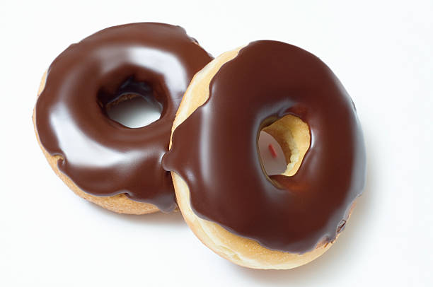 Two Chocolate Donuts Isolated on a White Background stock photo