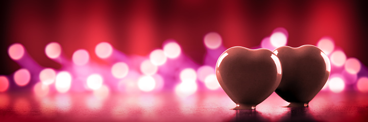 istock Two Chocolate Hearts With Soft Bokeh Lights 1190296345