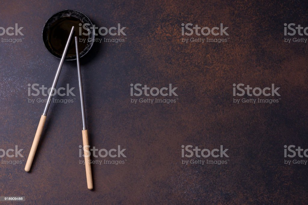 Two chopsticks and soy sauce for sushi stock photo