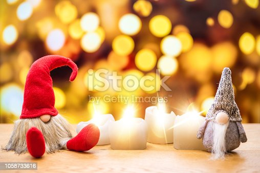 istock Two christmas dwarfs with bokeh lights in background 1058733616