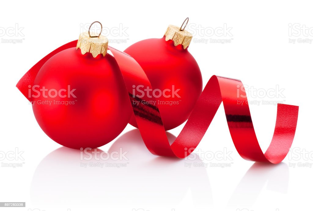 Two Christmas red bauble and curling paper Isolated on white background stock photo