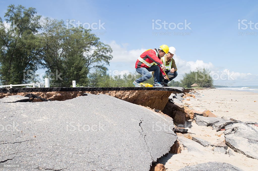 Two Civil Engineer check Beach Road stock photo