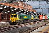 two class 66 diesel electric freight locomotives by Freightliner pass Rugby Station