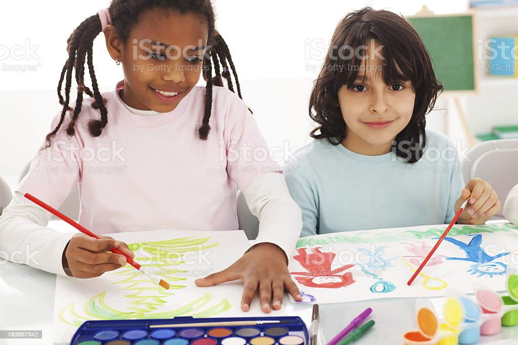 Two classmates are painting with watercolors. royalty-free stock photo