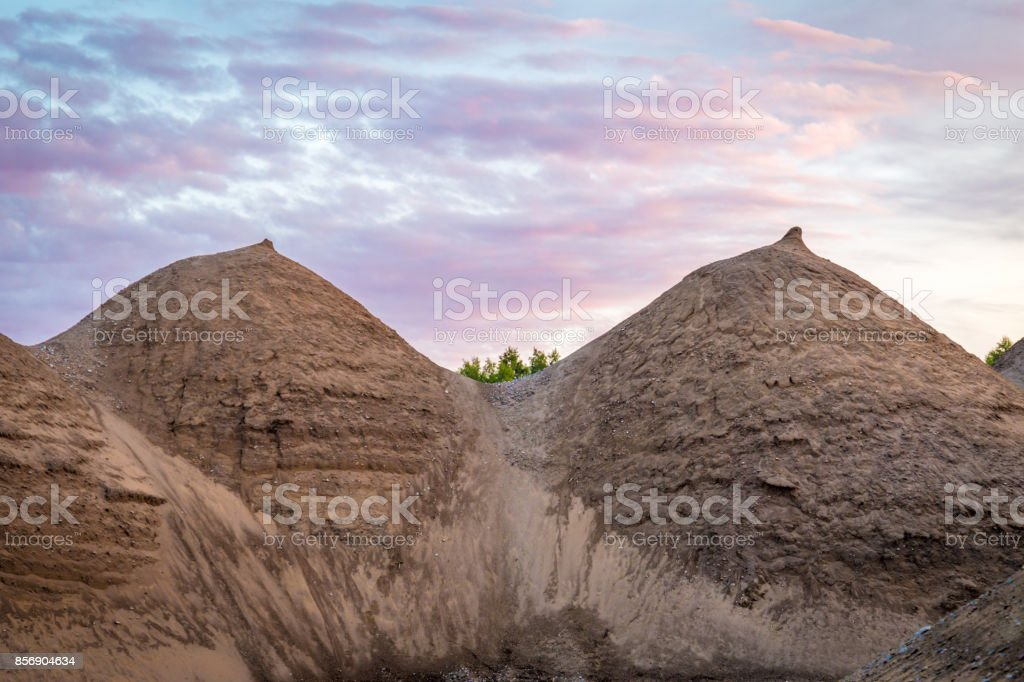 Two clay hills that resemble boobs with nipples on pink background stock photo