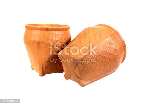 istock Two clay pot in weave wooden style isolated on white 626268400