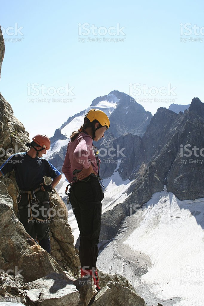 two climbers looking down royalty-free stock photo