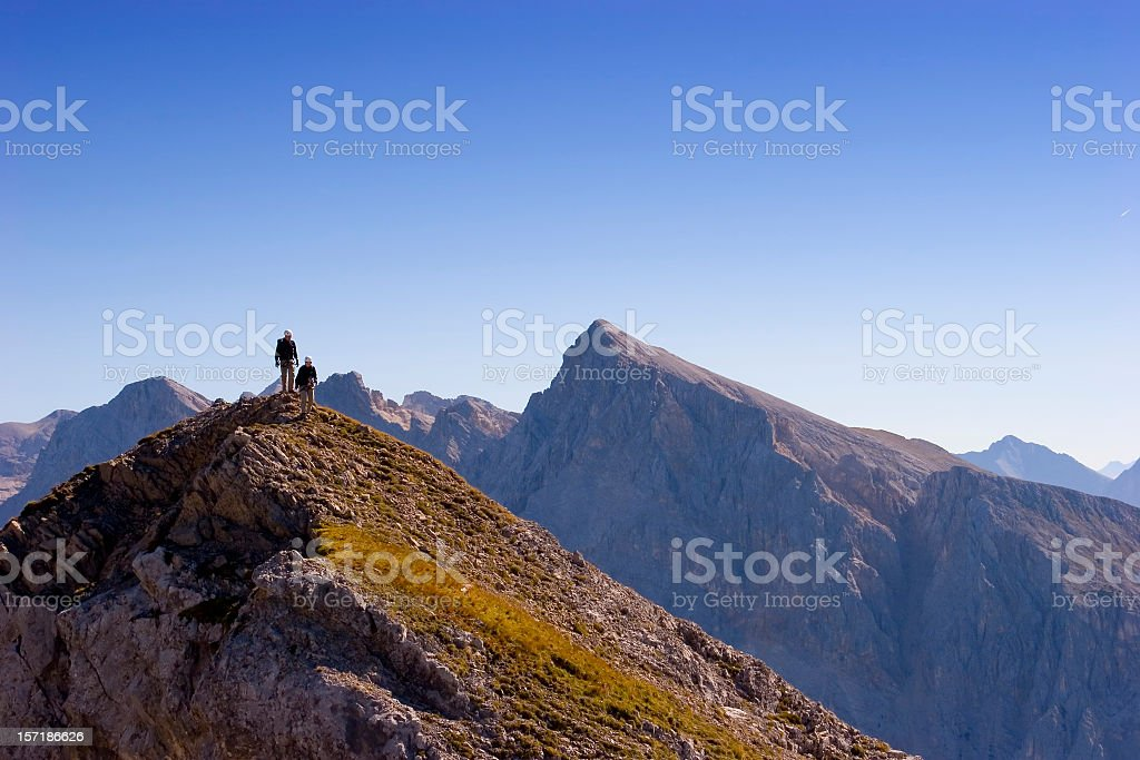 Two climbers on the top of a mountain royalty-free stock photo