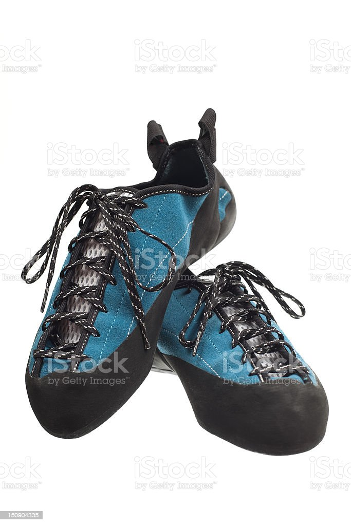 Two climbing shoes propped against each other stock photo