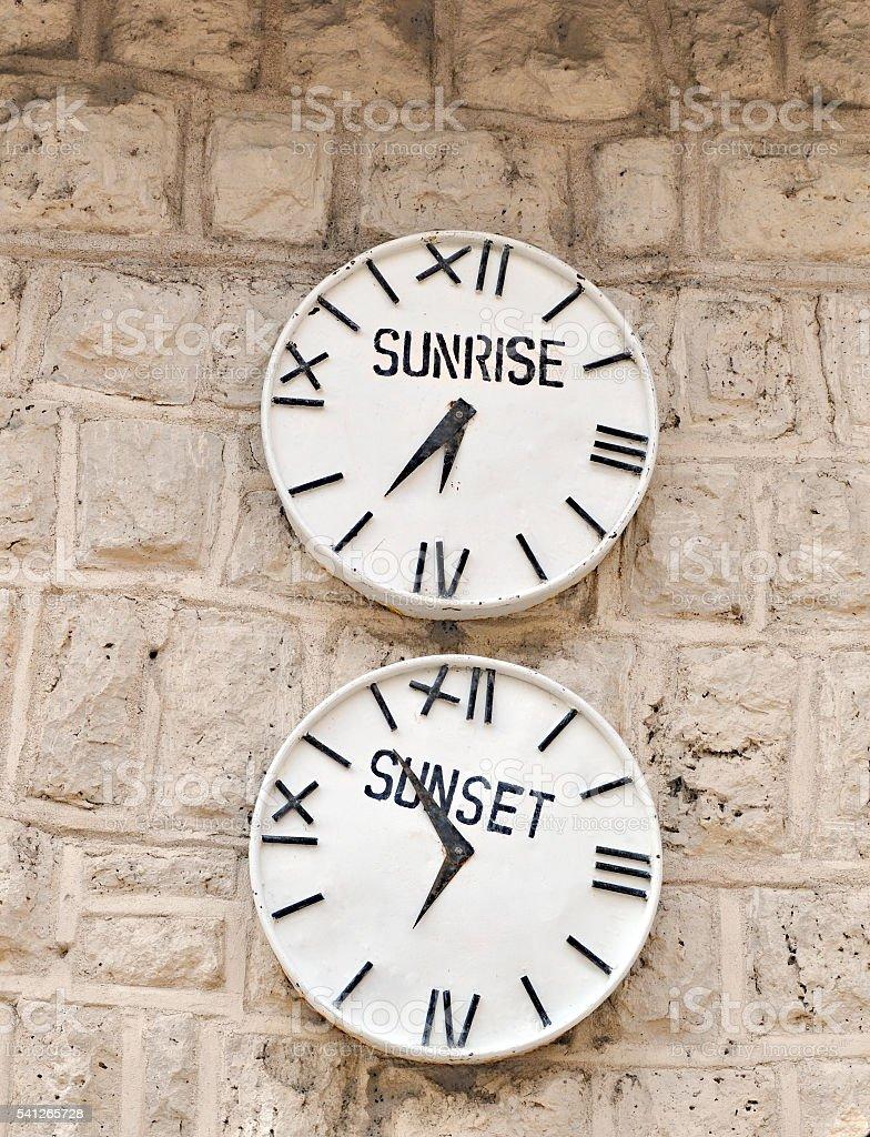 Two clocks at one of the gates entering Etosha National Park,...