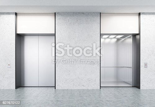istock Two closed and open elevators in corridor with concrete walls 627670122