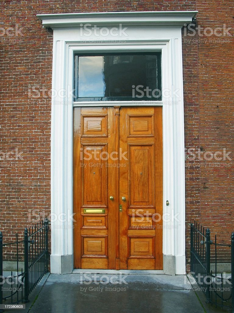 Two closed wooden oak business doors royalty-free stock photo