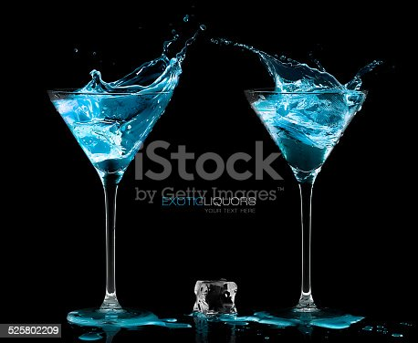 istock Two Cocktail Glasses with Blue Vodka. Style and Celebration Concept 525802209