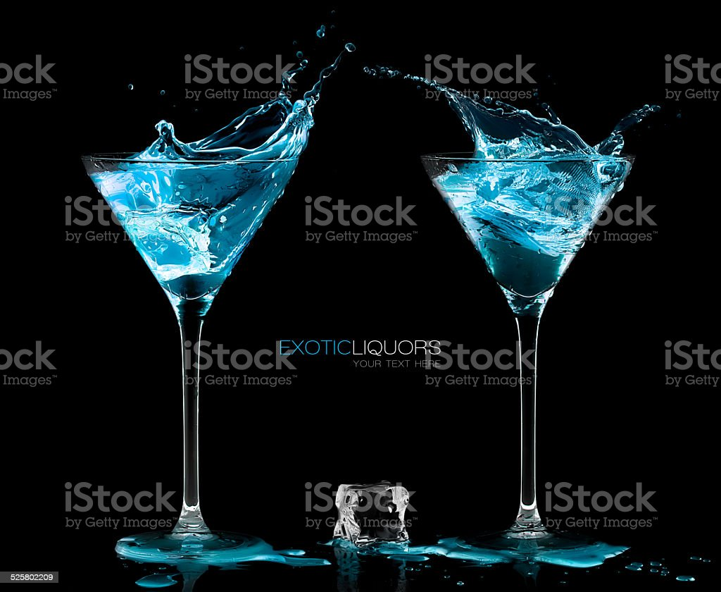 Two Cocktail Glasses with Blue Vodka. Style and Celebration Concept stock photo