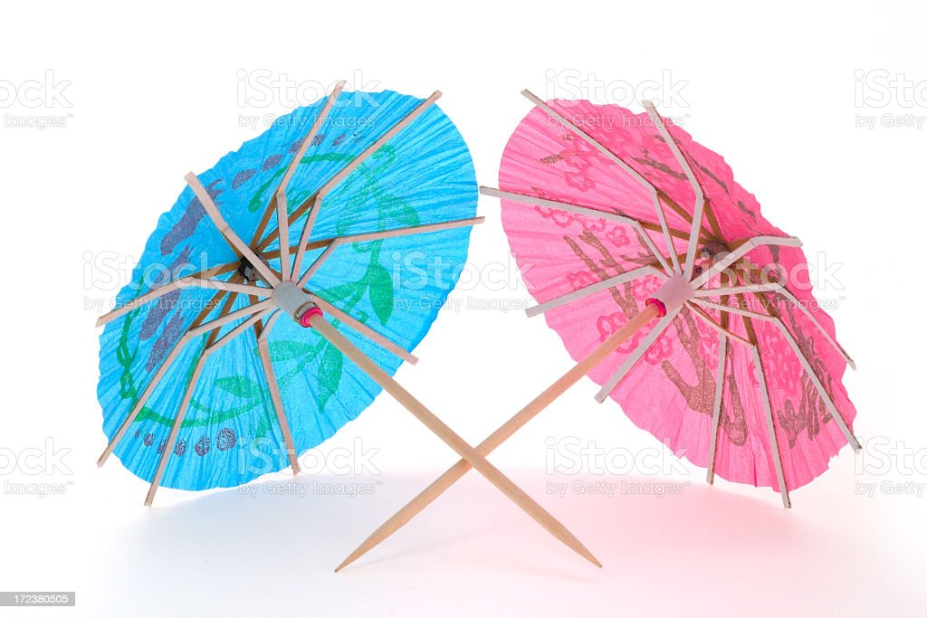Two cocktail umbrellas royalty-free stock photo