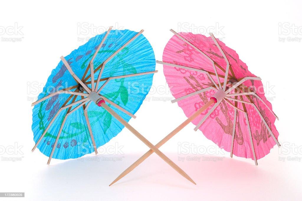 Two cocktail umbrellas stock photo