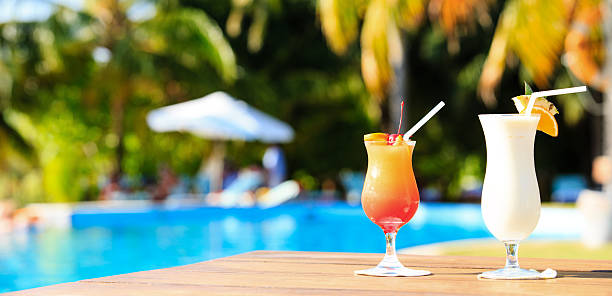 two cocktails on luxury tropical beach resort, panorama - standing water stock pictures, royalty-free photos & images
