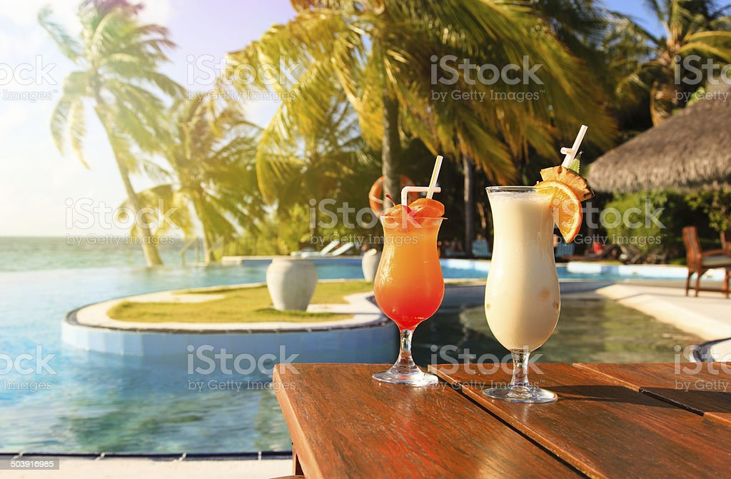 Two cocktails on tropical vacation stock photo