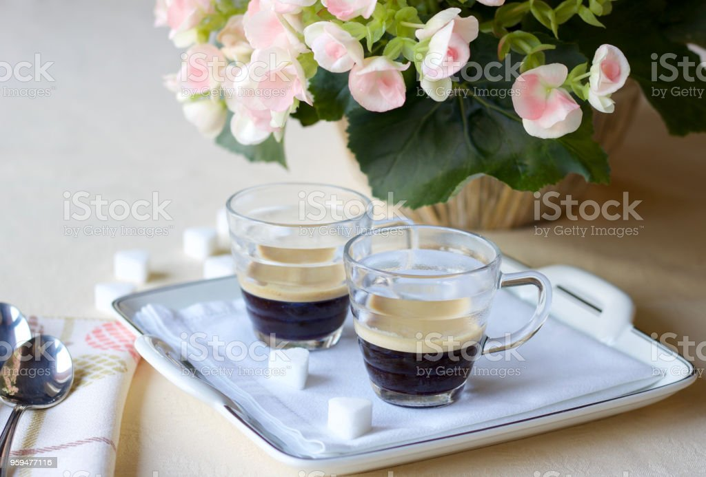 two coffee cups of italian espresso coffee on the table on a...