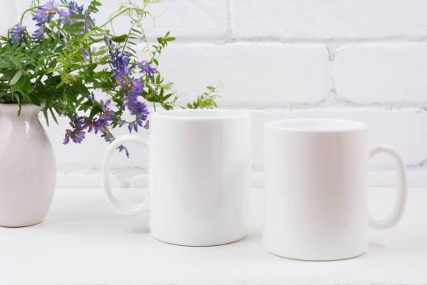 Two coffee mug mockup with mouse peas stock photo