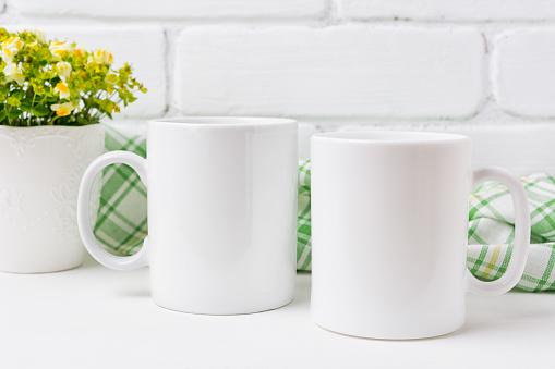 Two coffee mug mockup with yellow and green flowers