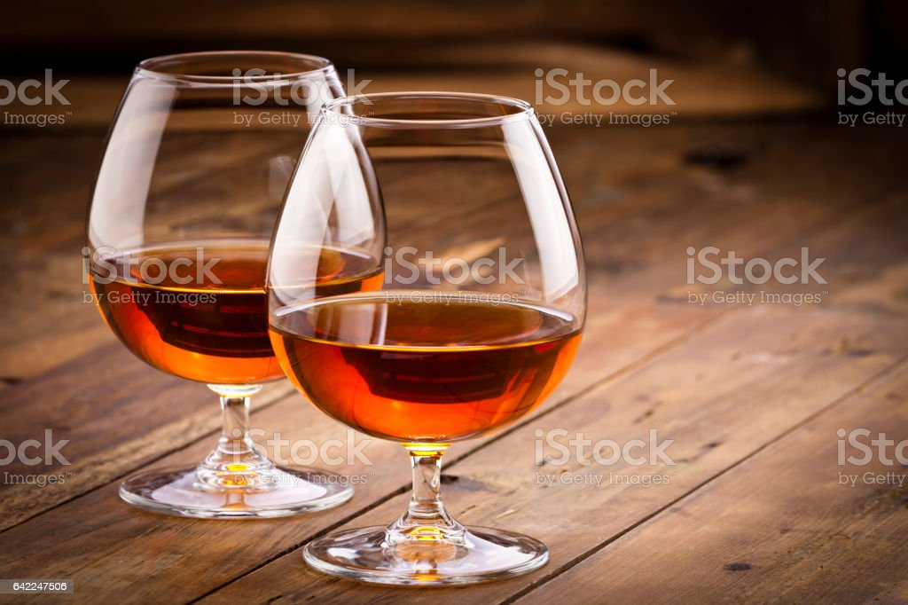 Two cognac snifters stock photo