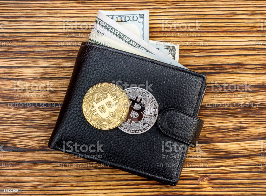 Two coin of bitcoin on closed wallet with dollars. Business concept. Top view. stock photo