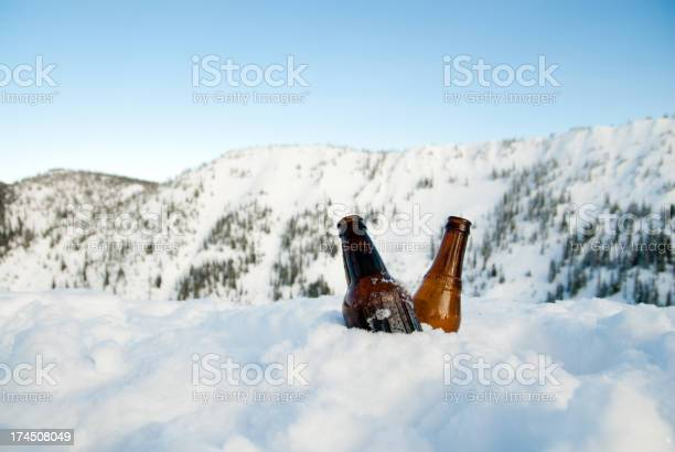 Photo of Two Cold Beer in Snow on Top of a Mountain
