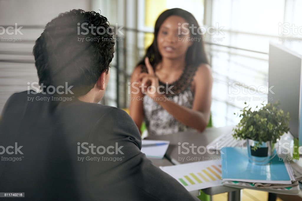 Two  colleages disagreeing and fighting at work stock photo
