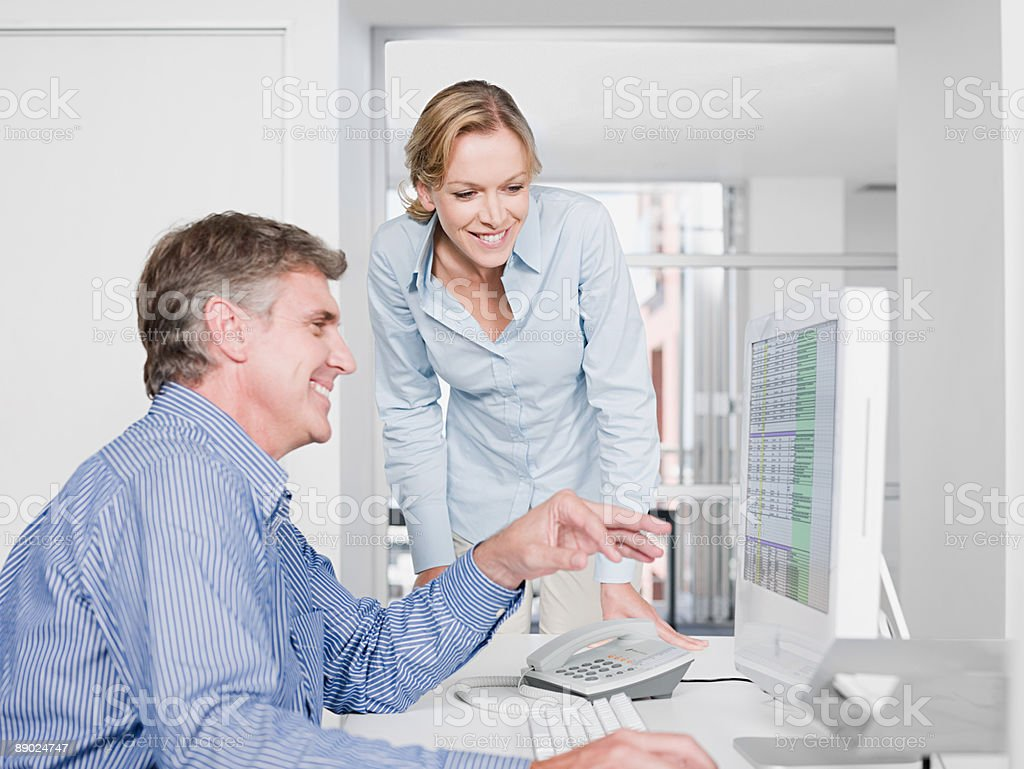 Two colleagues at a computer royalty-free stock photo