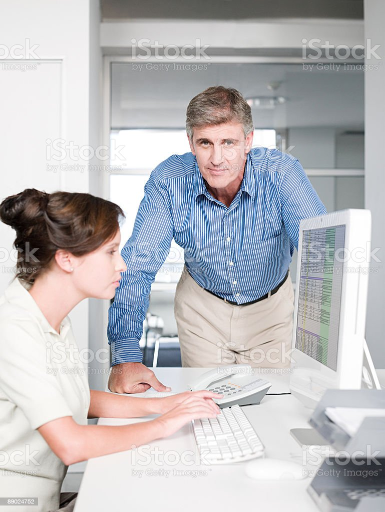 Two colleagues at a desk royalty-free stock photo