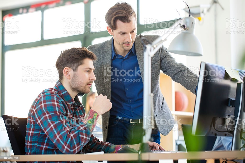 Two colleagues at a start up enjoying work stock photo