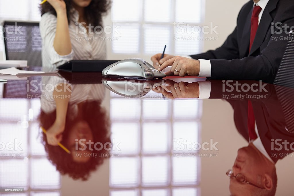 Two colleagues doing conference call royalty-free stock photo
